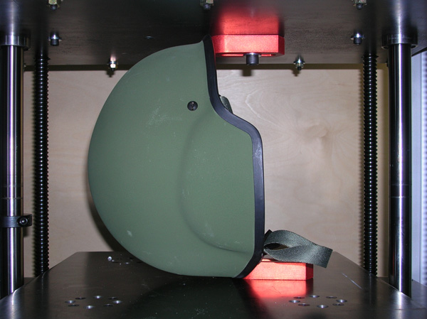 Helmet being tested for shell stiffness