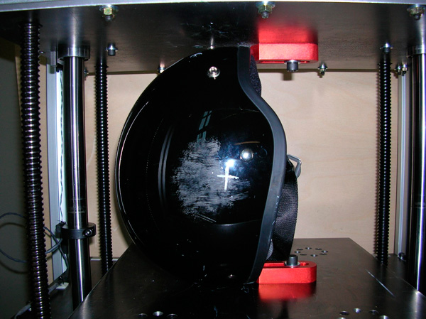 Motorcycle helmet being tested for shell stiffness